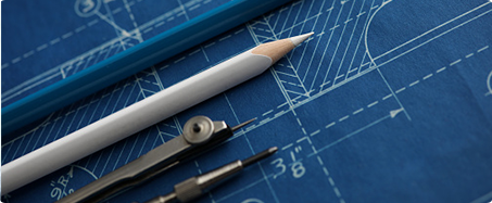 Photo of blueprint with compass and grey pencil