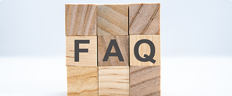 Photo of 3x3 stack of wooden blocks with letters that spell FAQ