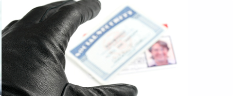 Photo of hand in black glove reaching for Social Security card