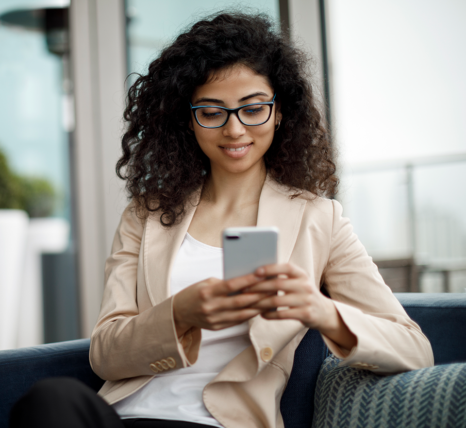 Photo of woman in sportcoat reading smartphone in hands