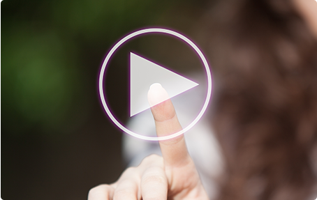 Photo of finger pressing video play icon
