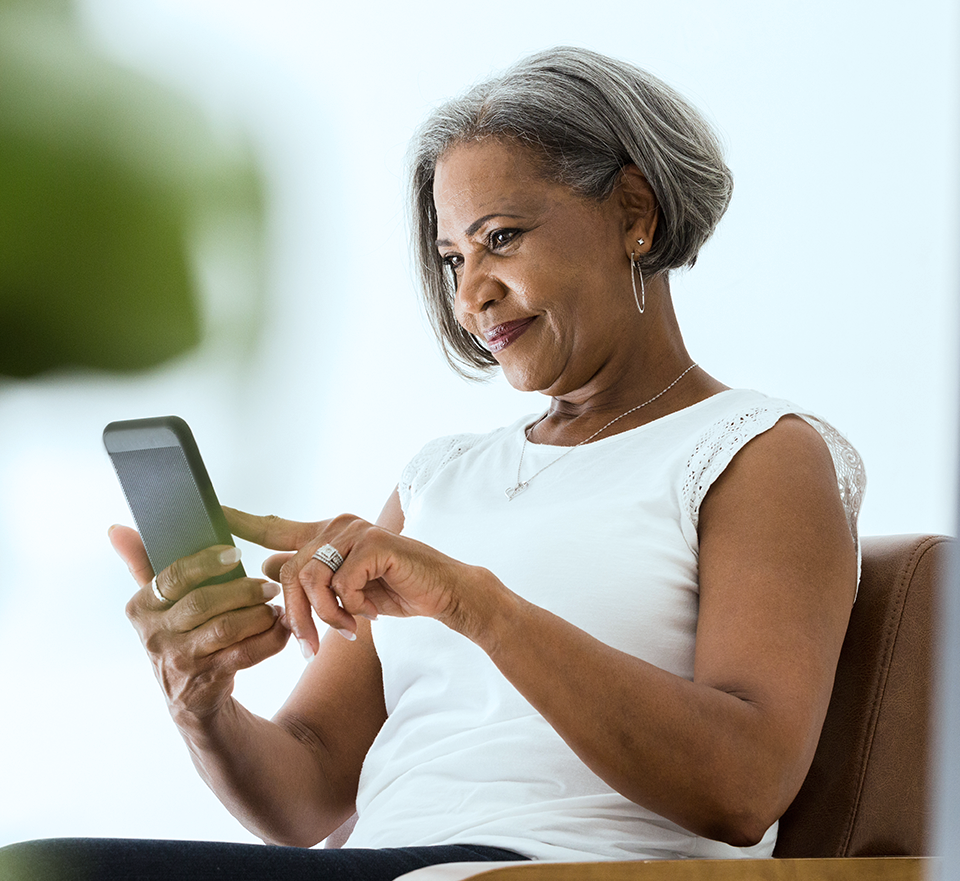 Photo of woman touching smarphone she is reading