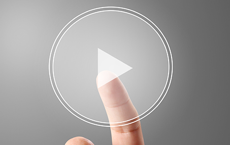 Photo of finger touching play icon